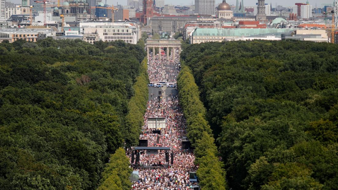 Thousands attend a protest against coronavirus restrictions at the Brandenburg Gate in Berlin on Saturday, August 1.