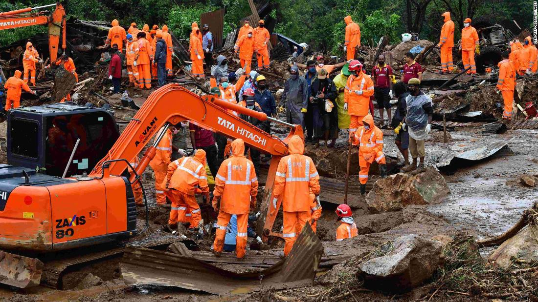 Rescue workers search for missing people at a landslide site caused by heavy rains in Pettimudy, in Kerala state, on August 8, 2020.