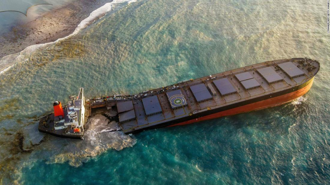 This aerial view taken on August 6, 2020 shows a large patch of leaked oil and the vessel MV Wakashio (R), belonging to a Japanese company but Panamanian-flagged, that ran aground near Blue Bay Marine Park off the coast of south-east Mauritius. - France on August 8, 2020 dispatched aircraft and technical advisers from Reunion to Mauritius after the prime minister appealed for urgent assistance to contain a worsening oil spill polluting the island nation's famed reefs, lagoons and oceans. Rough seas have hampered efforts to stop fuel leaking from the bulk carrier MV Wakashio, which ran aground two weeks ago, and is staining pristine waters in an ecologically protected marine area off the south-east coast. (Photo by STRINGER / AFP) (Photo by STRINGER/AFP via Getty Images)