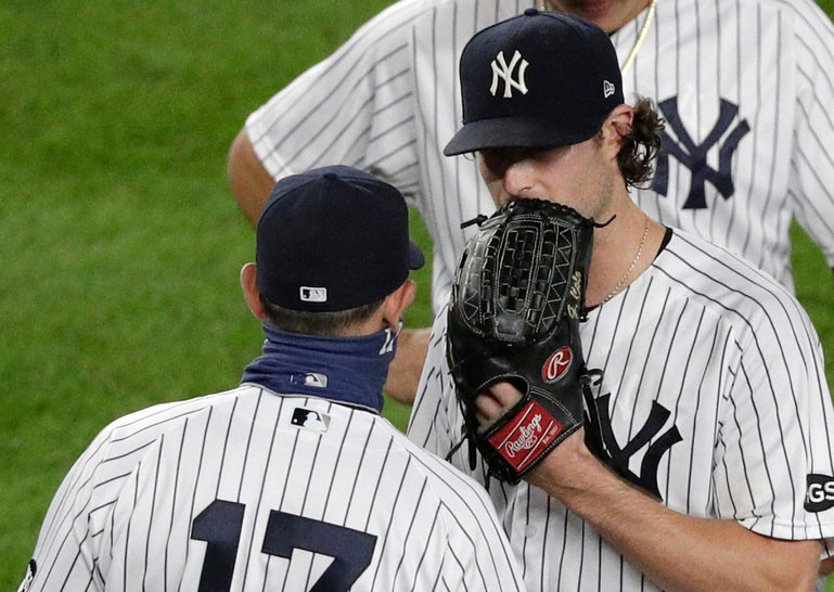 An upset Gerrit Cole has some words for Aaron Boone after getting pulled in the seventh inning of the Yankee's 4-2 loss to the Rays on Wednesday night.